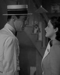Rex Harrison (as Gus Bennett) and Margaret Lockwood (as Anna Bomasch) in a screenshot from Night Train to Munich (1940) (2)