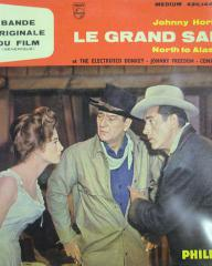 Capucine (as Michelle 'Angel' Bonet), John Wayne (as Sam McCord) and Stewart Granger (as George Pratt) in a French record sleeve from North to Alaska (1960) (1)