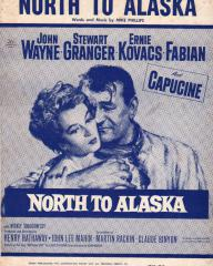 Capucine (as Michelle 'Angel' Bonet) and John Wayne (as Sam McCord) in sheet music from North to Alaska (1960) (1)