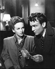Joan Greenwood (as Jenny Carden) and John Mills (as Jim Ackland) in a photograph from The October Man (1947) (5)