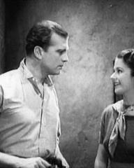 John Loder (as David Moore) and Margaret Lockwood (as Jeannie McAdam) in a screenshot from Owd Bob (1938) (3)