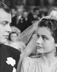 Derek Farr (as Dallas Chaytor) and Margaret Lockwood (as Janet Royd) in a photograph from Quiet Wedding (1941) (1)