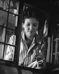 Derek Farr (as Denys Royd), Barbara White (as Miranda Bute) and Helen Shingler (as Rowena Hyde) in a screenshot from Quiet Weekend (1946) (2)