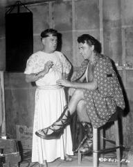 Countrymen – Stewart Granger and Basil Sydney chat about England on the set of Columbia's Technicolor drama, Salome, in which Rita Hayworth plays the title role