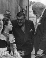 Joan Greenwood chats with painter Augustus John (1878 – 1961) and sculptor Barney Seale between scenes of the Ealing Studios production of the film 'Saraband For Dead Lovers'