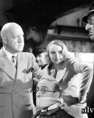 Alfred Drayton (as Christopher Watney) and Sandra Storme (as Sadie) in a photograph from A Spot of Bother (1938) (1)
