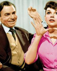 Norman Maine (James Mason) and Vicki Lester (Judy Garland) in a scene from the 1954 film, A Star is Born