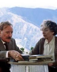 Col Tusker Smalley (Trevor Howard) and Lucy Smalley (Celia Johnson) sit in front of mountains and chat in Staying On (1980)