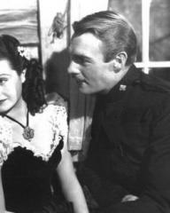 Margaret Lockwood (as Vicky Standing) and Randolph Scott (as Inspector Angus 'Monty' Montague) in a photograph from Susannah of the Mounties (1939) (6)