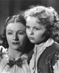 Margaret Lockwood (as Vicky Standing) and Shirley Temple (as Susannah Sheldon) in a photograph from Susannah of the Mounties (1939) (7)