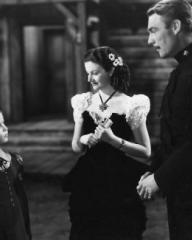 Shirley Temple (as Susannah Sheldon), Margaret Lockwood (as Vicky Standing) and Randolph Scott (as Inspector Angus 'Monty' Montague) in a photograph from Susannah of the Mounties (1939) (8)
