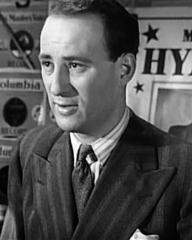 Morry Hyams (Sydney Tafler) in his store in a scene from It Always Rains on Sunday (1947)