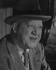 Alfred Drayton (as Mr. Knight) in a screenshot from They Knew Mr Knight (1944) (2)