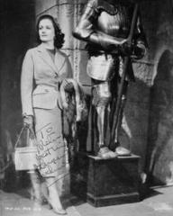 Autographed photo of Margaret Lockwood as Marissa Menzies standing next to a suit of armour in Trouble in the  Glen