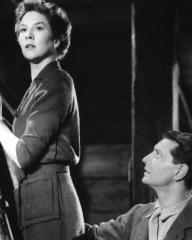 Torquil (Roger Livesey) looks up at Joan (Wendy Hiller) who is up a ladder in I Know Where I'm Going!