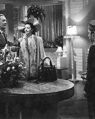 The honeymoon couple (Ian Hunter and Margaret Lockwood) are interrupted by the appearance of the page boy in their hotel suite