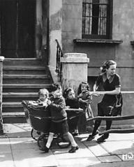 Lottie Smith (Joan Greenwood) wheels the ramshackle pram containing her younger brothers and sisters down the streets of a dock city in which she 'lives' in sordid surroundings.  Lottie tells this episode in her life to the warden of the remand home to which she is later sent on a charge of trying to murder her child and commit suicide herself.