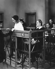 Lucy Glover (Margaret Lockwood), as warden of a remand home, comforts Lottie Smith (Joan Greenwood) when she is brought into court to be tried for attempting to kill her baby and commit suicide herself