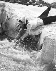 In desperation, Lucy Glover (Margaret Lockwood) tries to rescue her husband, Dick (Dennis Price), who, while teaching her to ski during their honeymoon in Finland, has fallen into an ice hole.    Her struggles are in vain and she screams hysterically as the swirling current drags him down