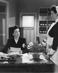 The matron (Bryl Wakely) tells Lucy Glover (Margaret Lockwood), the warden of the remand home, that her former husband, Mr Justice Templar, has called to see her