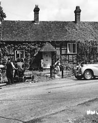 The charming cottage at Newlands Corner, which was chosen by the director of The White Unicorn as a suitable exterior for a scene in which Norey, Lucy's child, runs into the road and gets knocked down by a motor car
