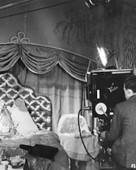 Arthur Grant (camera operator) gets everything in order before taking a shot of Margaret Lockwood, who plays the role of Lucy Templar in The White Unicorn