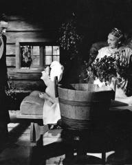 Dick (Dennis Price) and Lucy Glover (Margaret Lockwood) spend their honeymoon in Finland.  Shura (Lily Kahn) gives Lucy a Finnish steam bath and Dick asks her how she likes it.  A scene from the John Corfield production 'The White Unicorn', produced by Harold Huth and directed by Bernard Knowles.  Eagle-Lion distribution.