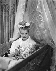 Margaret Lockwood's little daughter, Margaret Julia Lockwood, plays the part of Norey, Lucy's child. Norey is sitting in her cot waiting for her mother's good night kiss