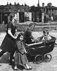 Lottie Smith (Joan Greenwood) is wheeling her brothers and sisters in a ramshackle pram near the docks. Lottie tells this episode in her life to the warden of the remand home to which she is later sent on a charge of trying to murder her child and commit suicide herself