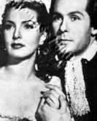 Patricia Roc (as Caroline) and Griffith Jones (as Sir Ralph Skelton) in a photograph from The Wicked Lady (1945) (29)