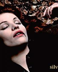 Mildred (Yvonne Mitchell) lies on the ground with blood oozing from her mouth
