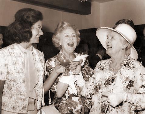 Margaret Lockwood and Cicely Courtneidge raise a toast to Sybil Thorndike