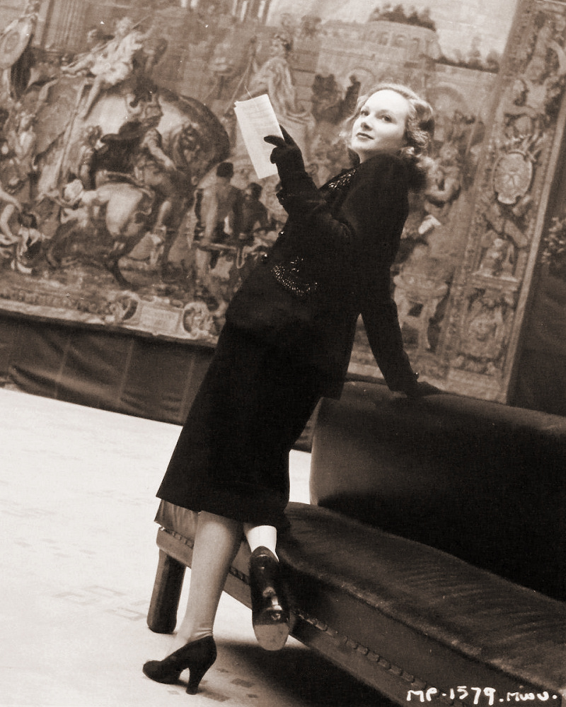 Lovely petite golden-haired Joan Greenwood takes a day off from filming in The White Unicorn to pay a visit to the Victoria and Albert Museum.    Daughter of a well-known artist she takes a keen interest in the wonderful tapestries.   Directed by Bernard Knowles, The White Unicorn stars Margaret Lockwood, Ian Hunter, Dennis Price and Joan Greenwood.    It is for GFD distribution.