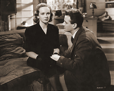 Lottie (Joan Greenwood) tells Paul (Paul Dupuis) that she is going to have a baby.    Paul pleads with her to be sensible; he says she is trying the old game to make him marry her