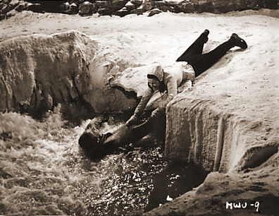 In desperation, Lucy Glover (Margaret Lockwood) tries to rescue her husband, Dick (Dennis Price), who, while teaching her to ski during their honeymoon in Finland, has fallen into an ice hole