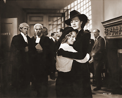 Lucy (Margaret Lockwood) decides to fight Lottie's (Joan Greenwood) case.    When she is brought up at the assizes, the judge is Lucy's ex-husband, Philip Templar. Lucy's eloquent plea in which she appeals for a chance for Lottie Smith, the little slum girl who never had an opportunity, softens Philip.    In cross examination he seems to be questioning Lucy rather than Lottie.    Lottie is bound over and allowed custody of her child.    Her relief is obvious when she flings her arms around Lucy, thanking her for putting her on the road to happiness