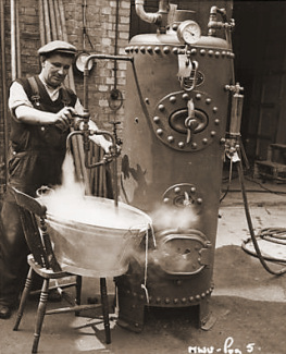 The boiler man at Nettlefold Studios preparing a bath of steaming hot water for a Finnish bath sequence in The White Unicorn