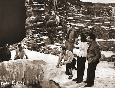 Margaret Lockwood and Dennis Price view the studio-constructed ice hole in which he fell to his death in the film, The White Unicorn