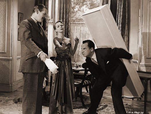 Guy Middleton (as Victor Manifold), Joan Greenwood (as Sabina Pennant) and Derek Farr (as Bruce Banning) in a photograph from Young Wives' Tale (1951) (6)
